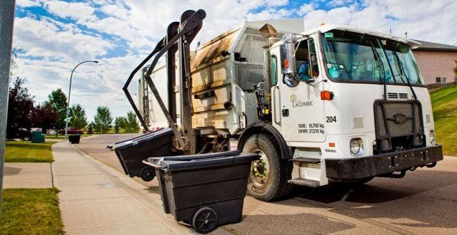 Lacombe Dump Truck Picking up Residential Waste